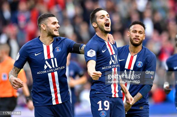 Pablo Sarabia of Paris SaintGermain is congratulated by teammates Mauro Icardi and Neymar Jr after scoring during the Ligue 1 match between Paris...