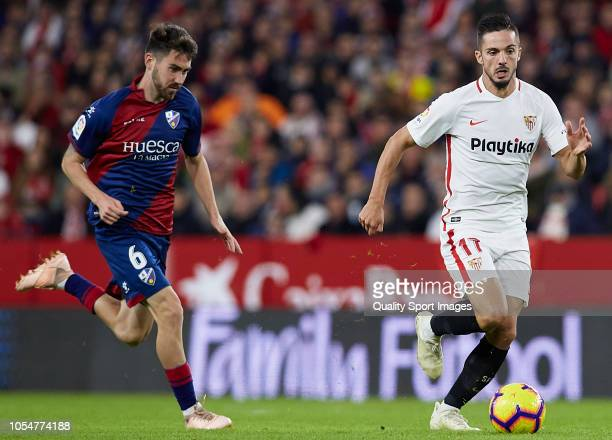 Pablo Sarabia of Sevilla competes for the ball with Moi Gomez of Huesca during the La Liga match between Sevilla FC and SD Huesca at Estadio Ramon...