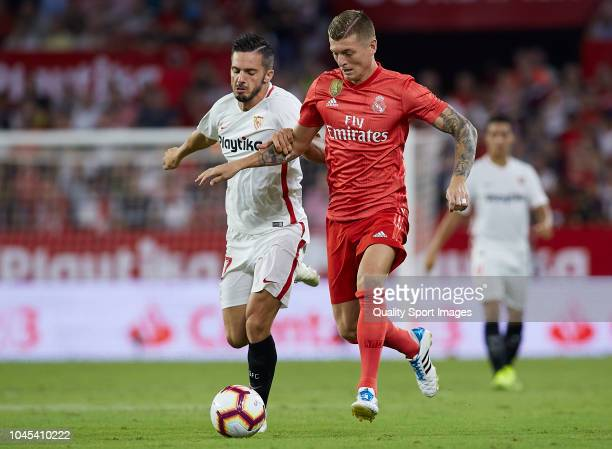 Pablo Sarabia of Sevilla competes for the ball with Toni Kroos of Real Madrid during the La Liga match between Sevilla FC and Real Madrid CF at...