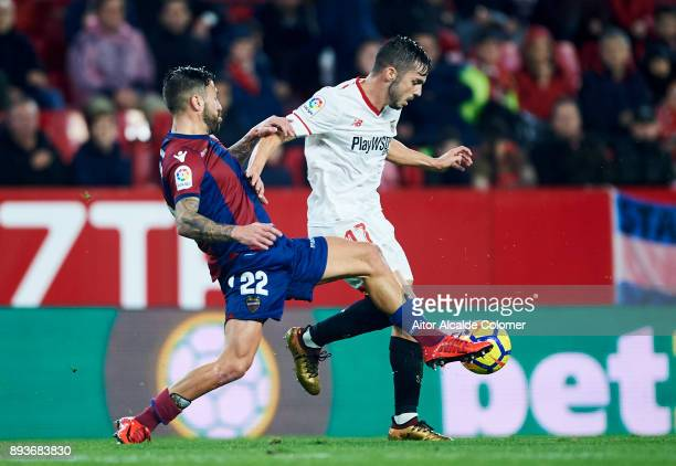 Pablo Sarabia of Sevilla duels for the ball with Antonio Luna of Levante during the La Liga match between Sevilla and Levante at Estadio Ramon...