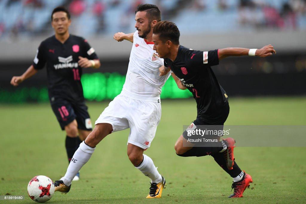 Pablo Sarabia of Sevilla FC (L) and Riku Matsuda of Cerezo Osaka (R) compete for the ball during the preseason friendly match between Cerezo Osaka and Sevilla FC at Yanmar Stadium Nagai on July 17, 2017 in Osaka, Japan.