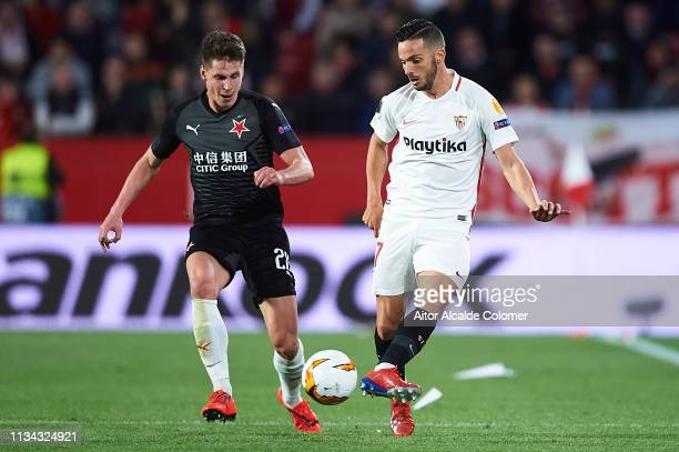 Pablo Sarabia of Sevilla FC being followed by Lukas Masopust of Slavia Prague during the UEFA Europa League Round of 16 First Leg match between...