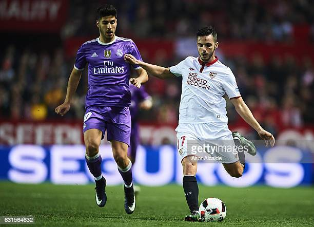 Pablo Sarabia of Sevilla FC being followed by Marco Asensioof Real Madrid CF during the Copa del Rey Round of 16 Second Leg match between Sevilla FC...