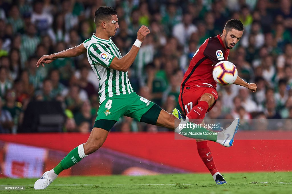 Pablo Sarabia of Sevilla FC (R) being followed by Zouhair Feddal of Real Betis Balompie (L) during the La Liga match between Real Betis Balompie and Sevilla FC at Estadio Benito Villamarin on September 2, 2018 in Seville, Spain.