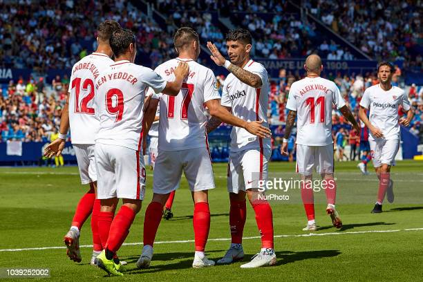 Pablo Sarabia of Sevilla FC celebrates a goal after scoring with his teammates Ever Banega and Ben Yedder during the La Liga match between Levante UD...