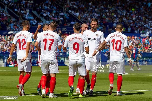 Pablo Sarabia of Sevilla FC celebrates a goal after scoring with his teammates Jesus Navas and Ever Banega during the La Liga match between Levante...