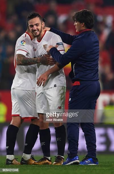 Pablo Sarabia of Sevilla FC celebrates after wining the match against Atletico de Madrid with his coach Vinzencio Montella of Sevilla FC during the...