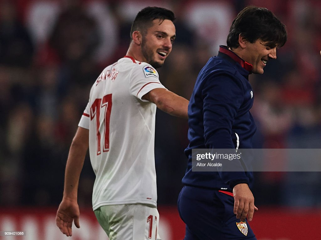 Pablo Sarabia of Sevilla FC (L) celebrates after wining the match against Atletico de Madrid with his coach Vinzencio Montella of Sevilla FC (R) during the Copa del Rey, Quarter Final, second Leg match between Sevilla FC and Atletico de Madrid at Estadio Ramon Sanchez Pizjuan on January 23, 2018 in Seville, Spain.