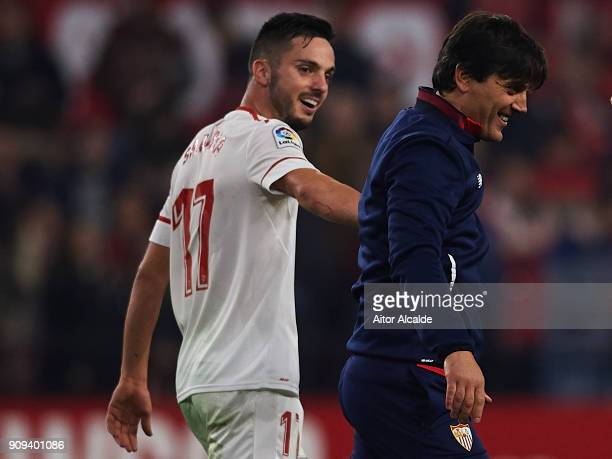 Pablo Sarabia of Sevilla FC celebrates after wining the match against Atletico de Madrid with his coach Vinzencio Montella of Sevilla FC during the...
