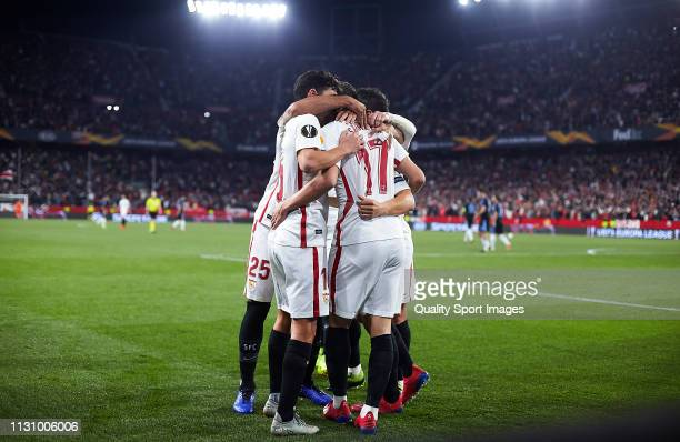 Pablo Sarabia of Sevilla FC celebrates scoring his team's second goal with team mates during the UEFA Europa League Round of 32 Second Leg match...