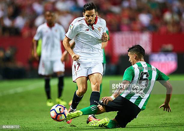 Pablo Sarabia of Sevilla FC competes for the ball with Felipe Gutierrez of Real Betis Balompie during the match between Sevilla FC vs Real Betis...