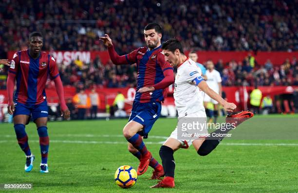 Pablo Sarabia of Sevilla FC duels for the ball with David Remeseiro 'Jason' of Levante UD during the La Liga match between Sevilla FC and Levante UD...