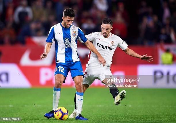 Pablo Sarabia of Sevilla FC duels for the ball with Didac Vila of RCD Espanyol during the La Liga match between Sevilla FC and RCD Espanyol at...