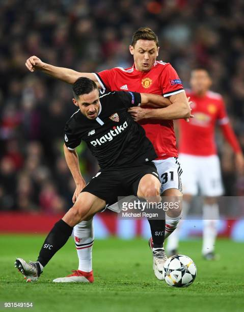Pablo Sarabia of Sevilla holds off Nemanja Matic of Manchester United during the UEFA Champions League Round of 16 Second Leg match between...
