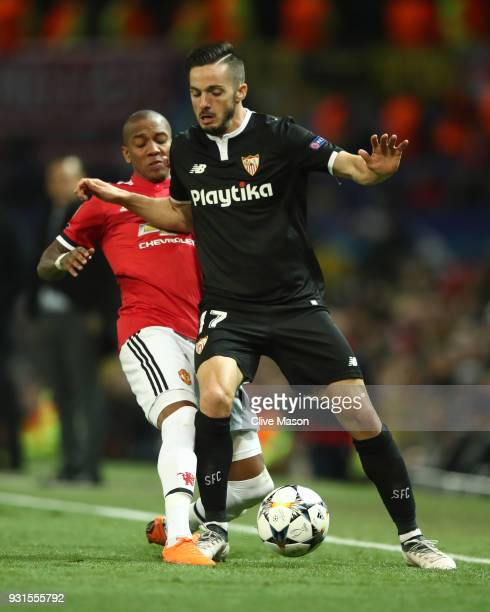 Pablo Sarabia of Sevilla is challenged by Ashley Young of Manchester United during the UEFA Champions League Round of 16 Second Leg match between...