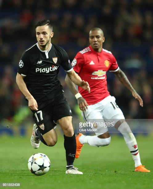 Pablo Sarabia of Sevilla is chased by Ashley Young of Manchester United during the UEFA Champions League Round of 16 Second Leg match between...