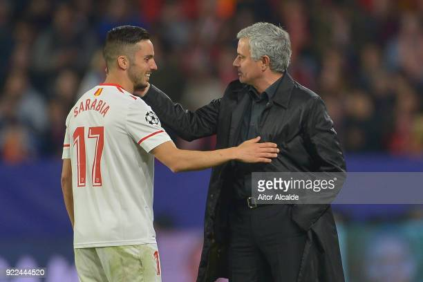 Pablo Sarabia of Sevilla speaks to Jose Mourinho Manager of Manchester United during the UEFA Champions League Round of 16 First Leg match between...