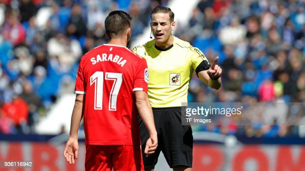 Pablo Sarabia of Sevilla speaks with the referee Javier Alberola Rojas during the La Liga match between Leganes and Sevilla at Estadio Municipal de...