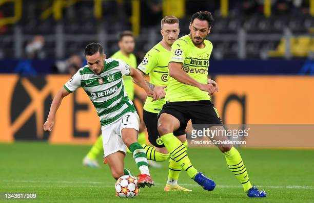 Pablo Sarabia of Sporting CP is challenged by Mats Hummels of Borussia Dortmund during the UEFA Champions League group C match between Borussia...