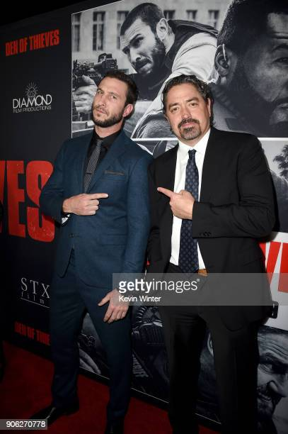 Pablo Schreiber and Christian Gudegast attend the premiere of STX Films' Den of Thieves at Regal LA Live Stadium 14 on January 17 2018 in Los Angeles...