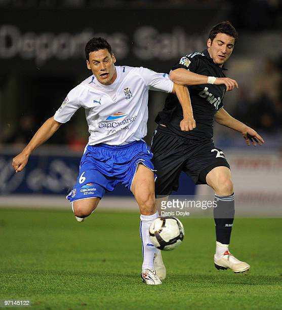 Pablo Sicilia of Tenerife fights for the ball against Gonzalo Higuain of Real Madrid during the La Liga match between Tenerife and Real Madrid at the...