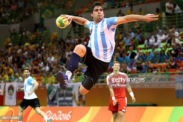 Pablo Simonet of Argentina shoots at goal during the Mens Preliminary Group A match between Denmark and Argentina at the Future Arena on Day 2 of the...