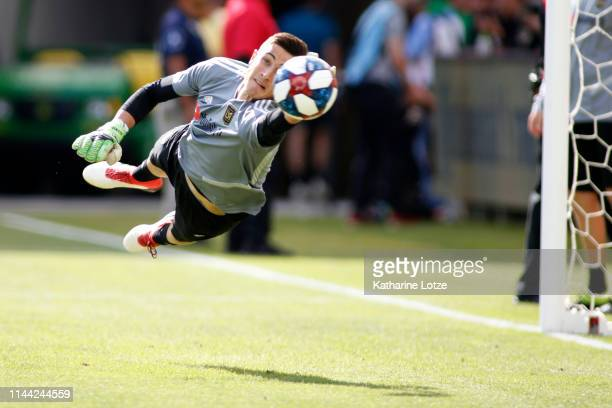 Pablo Sisniega of Los Angeles FC makes a save during a warm up exercise ahead of a game against the Seattle Sounders at Banc of California Stadium on...