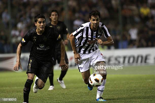 Pablo Velazquez from Libertad fights for the ball with Norberto Araujo from Liga Universitaria de Quito during a match between Liga Universitaria de...
