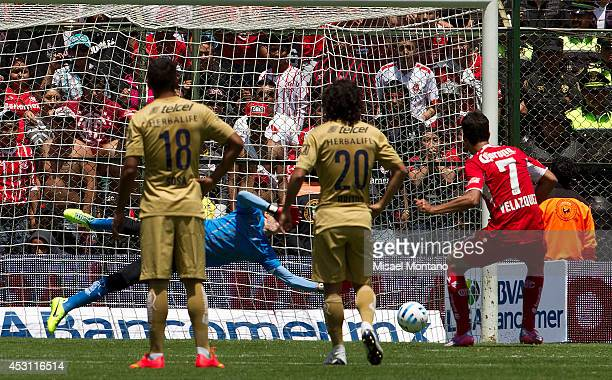 Pablo Velazquez of Toluca scores the opening goal against Pumas during a match between Toluca and Pumas as part of 4th round Apertura 2014 Liga MX at...