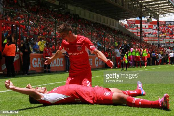 Pablo Velazquez of Touca celebrates with Isaac Brizuela after scoring the second goal against Pachuca during a match between Toluca and Pachuca as...