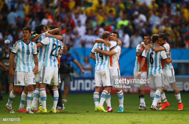 Pablo Zabaleta and Sergio Aguero of Argentina hug as they celebrate with teammates after defeating Belgium 10 during the 2014 FIFA World Cup Brazil...