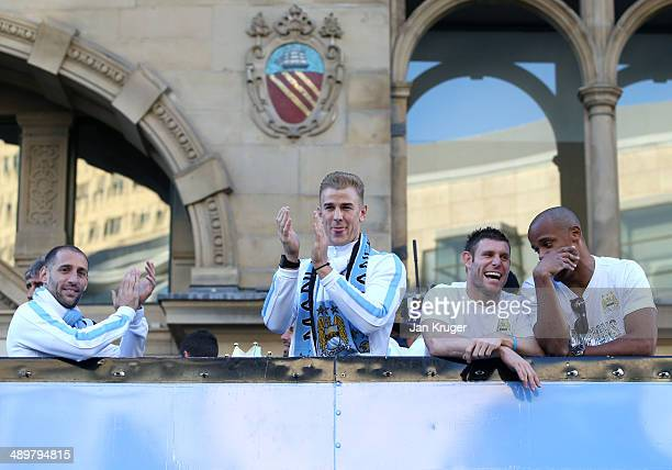 Pablo Zabaleta Joe Hart James Milner and Vincent Kompany look on during the Manchester City Premier League victory parade on May 12 2014 in...