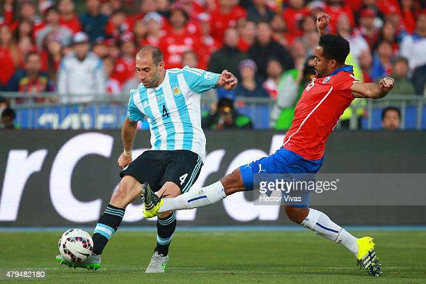 Pablo Zabaleta of Argentina fights for the ball with Jean Beausejour of Chile during the 2015 Copa America Chile Final match between Chile and...