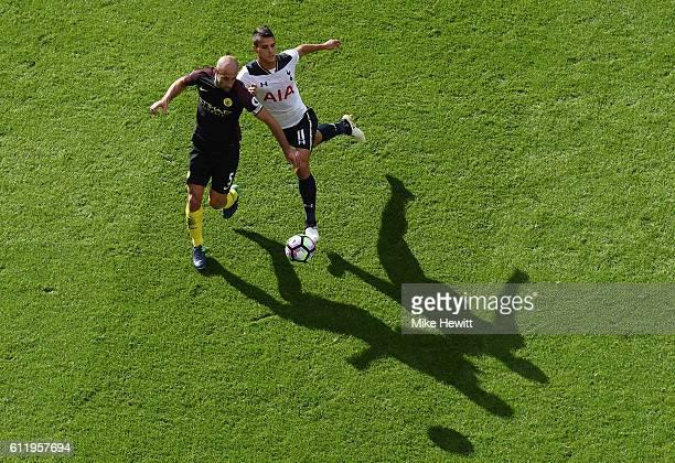 Pablo Zabaleta of Manchester City and Erik Lamela of Tottenham Hotspur battle for possession during the Premier League match between Tottenham...