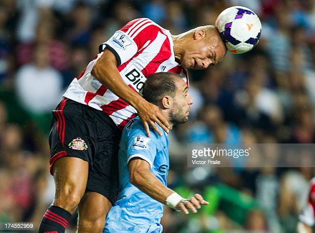 Pablo Zabaleta of Manchester City and Wes Brown of Sunderland jump for the ball during the Barclays Asia Trophy Final match between Manchester City...
