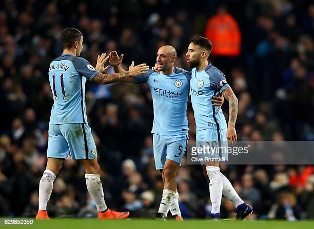 Pablo Zabaleta of Manchester City celebrates scoring his sides first goal with Aleksander Kolorov of Manchester City and Nicolas Otamendi of...