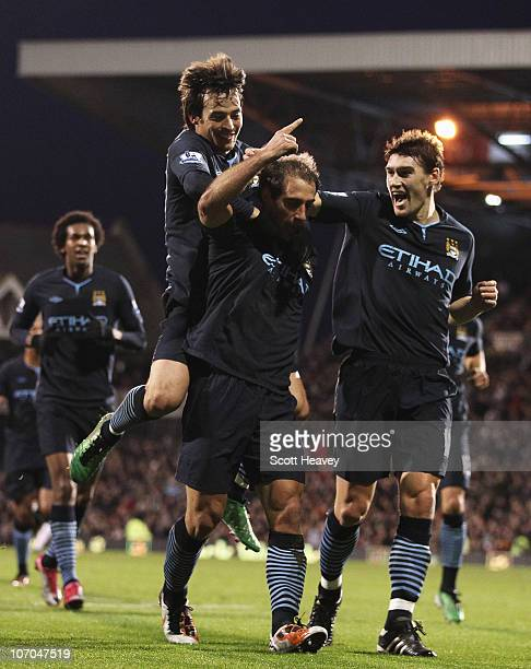 Pablo Zabaleta of Manchester City celebrates scoring his teams second goal with Gareth Barry and David Silva during the Barclays Premier League match...