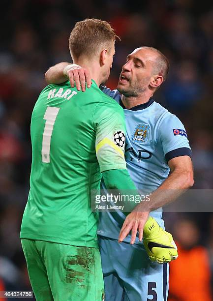Pablo Zabaleta of Manchester City hugs Joe Hart of Manchester City after he saved a penalty from Lionel Messi of Barcelona during the UEFA Champions...