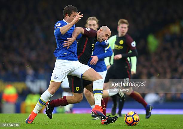 Pablo Zabaleta of Manchester City is challenged by Gareth Barry of Everton during the Premier League match between Everton and Manchester City at...