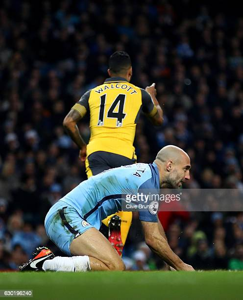 Pablo Zabaleta of Manchester City is dejected after Theo Walcott of Arsenal scored his sides first goal during the Premier League match between...