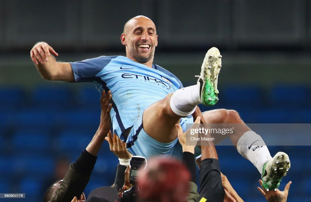 Pablo Zabaleta of Manchester City is thrown into the air by his Manchester City team mates after the Premier League match between Manchester City and West Bromwich Albion at Etihad Stadium on May 16, 2017 in Manchester, England.