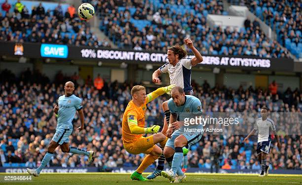 Pablo Zabaleta of Manchester City Joe Hart of Manchester City combine to prevent Jonas Olsson of West Bromwich Albion getting his headed shot at goal...