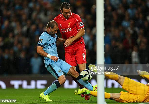 Pablo Zabaleta of Manchester City scores an own goal to make it 31 after goalkeeper Joe Hart of Manchester City fumbles the header from Rickie...