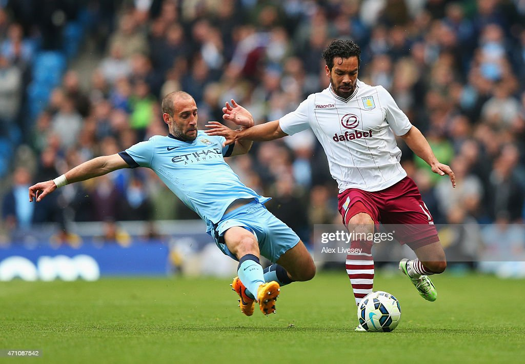 Pablo Zabaleta of Manchester City tackles Kieran Richardson of Aston Villa during the Barclays Premier League match between Manchester City and Aston Villa at Etihad Stadium on April 25, 2015 in Manchester, England.