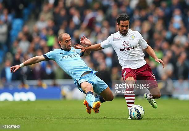 Pablo Zabaleta of Manchester City tackles Kieran Richardson of Aston Villa during the Barclays Premier League match between Manchester City and Aston...