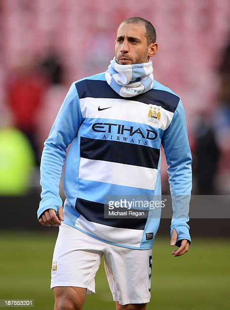 Pablo Zabaleta of Manchester City warms up in a snood ahead of the Barclays Premier League match between Sunderland and Manchester City at the...