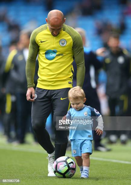 Pablo Zabaleta of Manchester City warms up with his child prior to the Premier League match between Manchester City and Leicester City at Etihad...