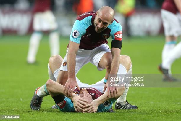 Pablo Zabaleta of West Ham and James Collins of West Ham celebrate their win during the Premier League match between West Ham United and Watford at...