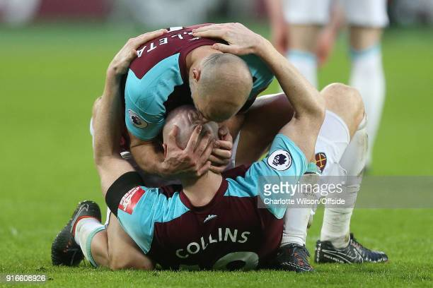 Pablo Zabaleta of West Ham kisses the head of James Collins of West Ham to celebrate their win during the Premier League match between West Ham...