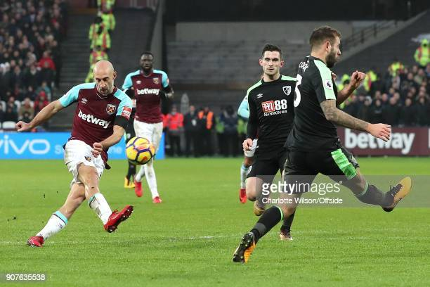 Pablo Zabaleta of West Ham shoots past Steve Cook of Bournemouth during the Premier League match between West Ham United and AFC Bournemouth at...
